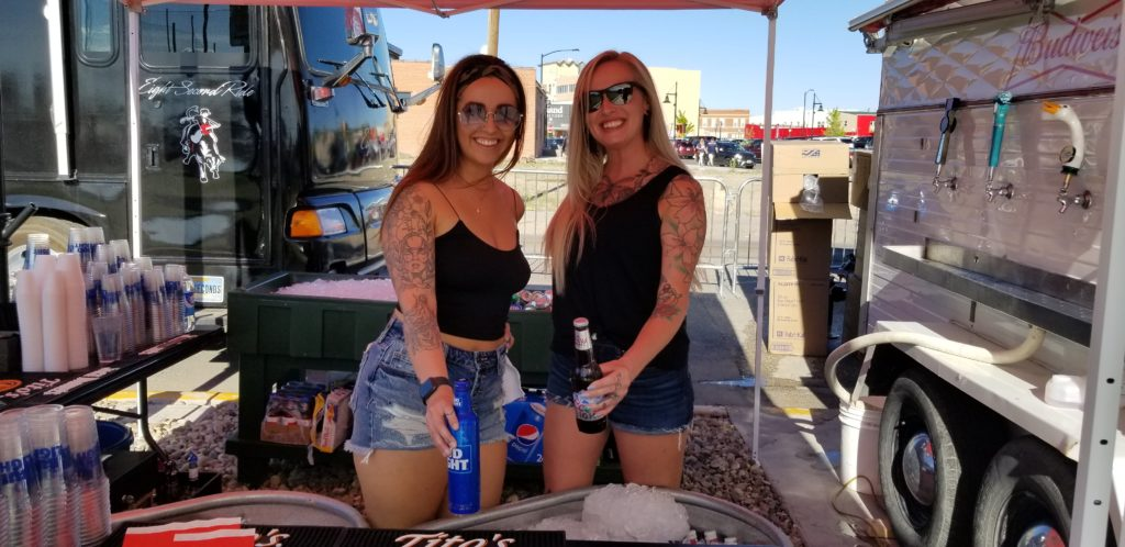 Two ladies serving drinks during the Easton Corbin concert