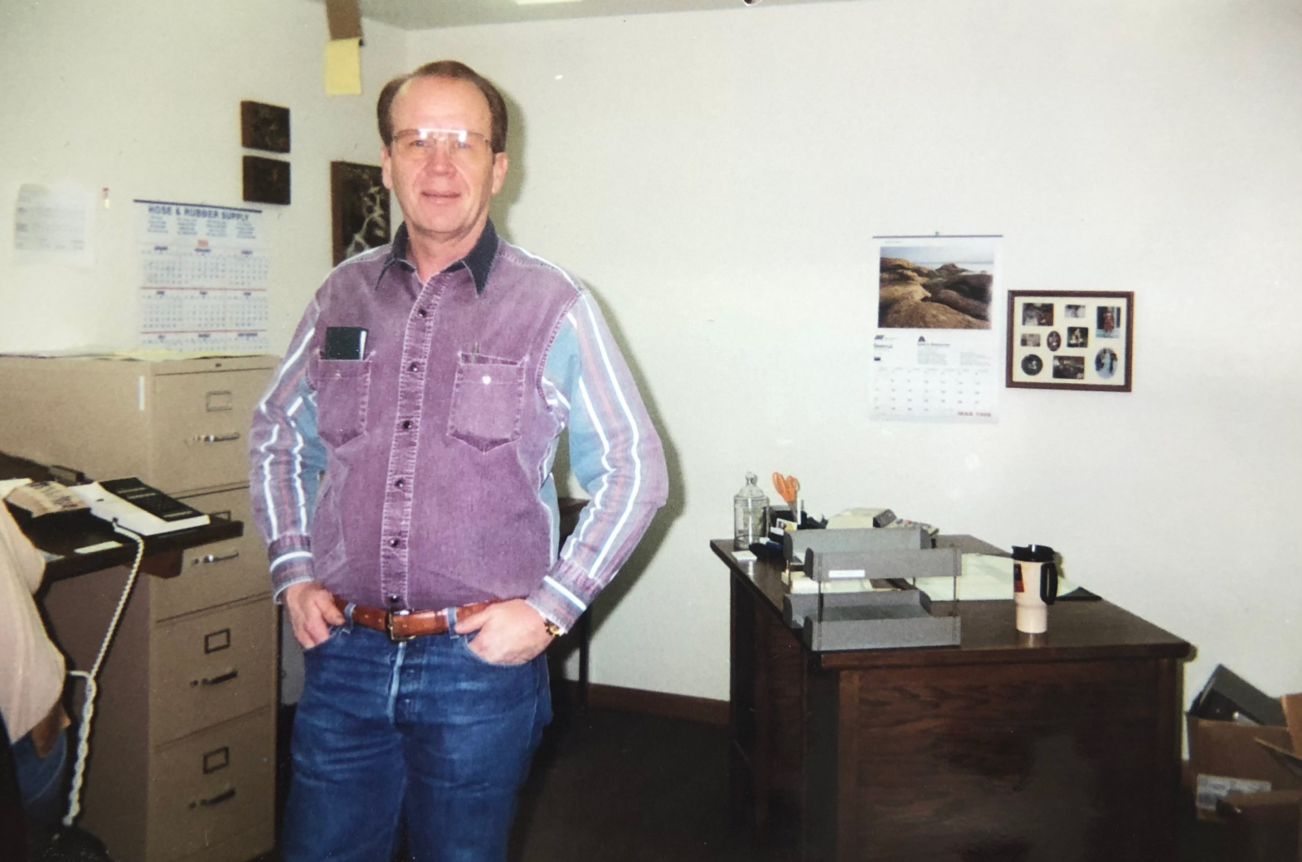 Founder Gary Waldo stands by his desk